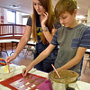 (Brad Davis/The Register-Herald) 13-year-old Oak Hill resident Grayson Wills and his mom Amanda make shaped chocolates, one of several different activities to partake in during the Beckley Art Center's Family Art Festival Saturday afternoon.