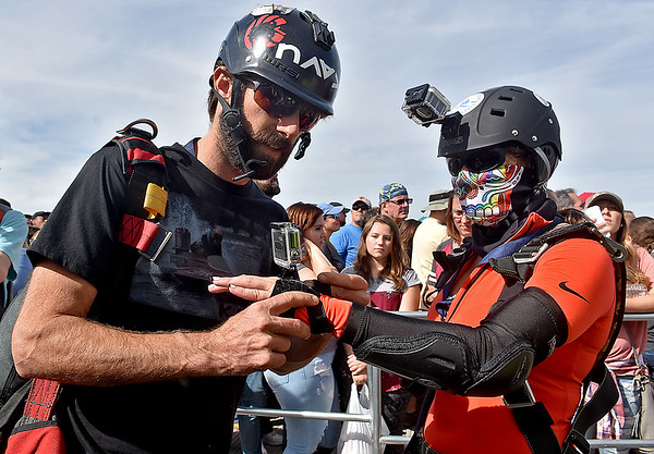 (Brad Davis/The Register-Herald) Fayetteville resident Kim Adkins gets some help in securing her video camera prior to her jump from Santa Cruz, California resident Jordan Kilgore during Bridge Day Saturday afternoon.