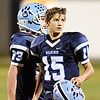 Meadow Bridge's Lukas Stephens  (15) and Nicholas White (23) during the end of the first quarter of their football game against Webster County Friday in Meadow Bridge. (Chris Jackson/The Register-Herald)