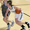 (Brad Davis/The Register-Herald) Wyoming East's Katie Daniels drives to the basket as George Washington's Dee McMillan defends during Big Atlantic Classic action Wednesday night at the Beckley-Raleigh County Convention Center.