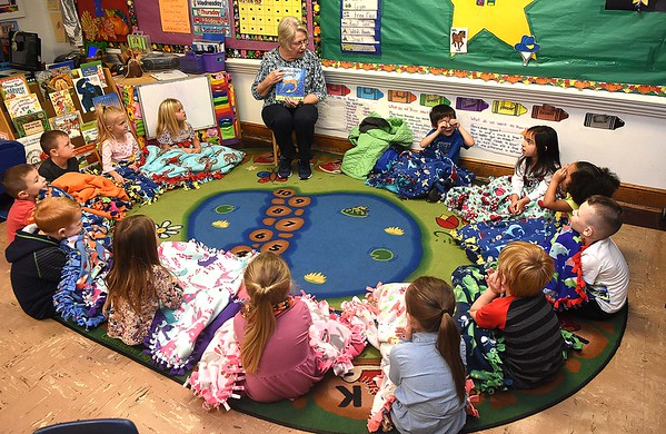 Linda Cole, co-president Fayette Co. chapter Read Aloud West Virginia, reads Giraffes Can't Dance book to pre-k students during the Snuggle & Read program held at Mount Hope Elementary School Wednesday morning.<br /> (Rick Barbero/The Register-Herald)