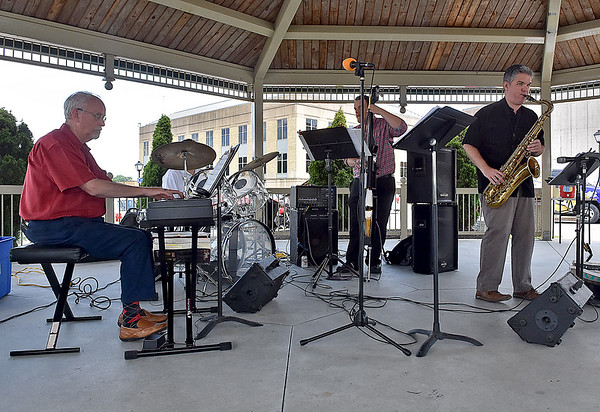 (Brad Davis/The Register-Herald) The Chris Oxley Quartet performs under the Jim Word Memorial Park gazebo during Fridays in the Park Yesterday afternoon.