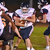 (Brad Davis/The Register-Herald) Independence quarterback Trey Gunnoe carries the ball against Summers County Friday night in Hinton.