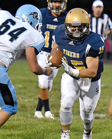 (Brad Davis/The Register-Herald) Shady Spring's Tyler Bragg carries the ball against Lincoln County Friday night in Shady Spring.