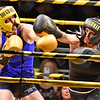 (Brad Davis/The Register-Herald) Defending champ and Fayetteville resident Sarah Coffey, left, takes on Lester's Misty Bowles during the Original Toughman Contest Friday night at the Beckley-Raleigh County Convention Center. Coffey would win the fight.