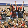 "(Brad Davis/The Register-Herald) Independence fans and family erupt in celebration and hold up ""four"" signs as they react to their wrestler Jacob Hart's fourth career state championship, this one in the 182-pound weight class, at the 70th Annual WVSSAC State Wrestling Tournament Saturday night at the Big Sandy Arena in Huntington. It's the first time in school history the wrestling team has had a four-time champ."