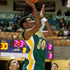 (Brad Davis/The Register-Herald) Greenbrier East's Rahzell Godfrey drives and scores against Woodrow Wilson Saturday night at the Beckley-Raleigh County Convention Center.