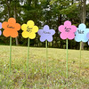 (Brad Davis/The Register-Herald) Flowers bearing the last names of many other families that are in some way related to Lillys are displayed underneath the large, printed family trees during the annual Lilly Family Reunion Saturday afternoon near Ghent.