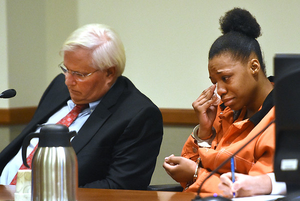 Camille Brown, right, wipes away tears during her hearing held before judge John Hutchison in Raleigh County Circuit Court. Sittin with Brown is her attorney Bill Forbes, of Charleston.<br /> (Rick Barbero/The Register-Herald)