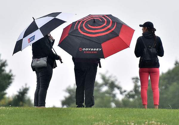 (Brad Davis/The Register-Herald) Unbrellas were a must-have during parts of BNI action Saturday afternoon at Grandview Country Club.