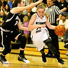 (Brad Davis/The Register-Herald) Wyoming East's Jazz Blankenship drives against Westside in the sectional championship February 22 in Clear Fork.