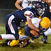(Brad Davis/The Register-Herald) Independence's Jared Goddard takes down Clay County's Luke Burnette as he carries the ball Friday night in Coal City.