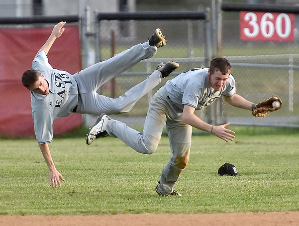 (Brad Davis/The Register-Herald) A scary moment unfolds during the bottom of the 4th inning as Wyoming East centerfielder D.J. Rose, right, and 2nd baseman Cameron Cook collide in pursuit of a fly ball during the Warriors' game at Oak Hill Friday evening. Both players would be ok, but Rose left the game with a bloody nose.
