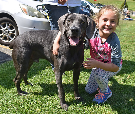 (Brad Davis/The Register-Herald) Five-year-old Maddie Gillespie and her dog Stryker during the Kids Classic Dazzling Dog Show Sunday afternoon at Youth Museum.