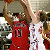 (Brad Davis/The Register-Herald) St. Albans' Aamyah Washington drives and scores as Washington's Kayla Reifke defends during Big Atlantic Classic action Thursday afternoon at the Beckley-Raleigh County Convention Center.