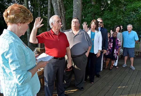 (Brad Davis/The Register-Herald) 2017 West Virginia Association of Realtors President Glenna Swiger, left, swears in new Beckley Board of Realtors during the conclusion of the board's annual installment ceremony Thursday evening at Daniel Vineyards. From second from left are Mike Tyree (1st VP), Tim Berry (2nd VP), Leigh Ann Wolfe (Secretary), Kevin Rasmussen (Treasurer), Sarah Milam, Marla Sinko, Pam Lynch and Jerry Zaferatos (all four local directors).
