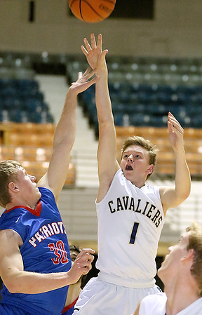 (Brad Davis/The Register-Herald) Greenbrier West's Noah Midkiff shoots as Midland Trail's Matt Scaggs defends during Big Atlantic Classic action Wednesday afternoon at the Beckley-Raleigh County Convention Center.