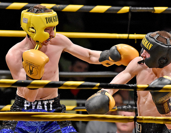 (Brad Davis/The Register-Herald) Oak Hill's Noah Pyatt, left, takes on Kaleb Edwards in a lightweight matchup during the Original Toughman Contest Friday night at the Beckley-Raleigh County Convention Center. Pyatt would win the fight.