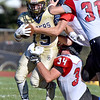 (Brad Davis/The Register-Herald) Shady Spring back Tyler Bragg is tackled by Oak Hill's Casey Wood Saturday afternoon in Shady Spring.