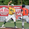 (Brad Davis/The Register-Herald) Miners 1st baseman Justin Mitchell makes a catch and putout on Chillicothe baserunner Kyle Orloff during a game against the Paints July 23 at Linda K. Epling Stadium.