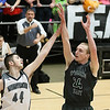 (Brad Davis/The Register-Herald) Wyoming East's Zachary Cook shoots as Westside's Corey Hatfield defends during the Class AA Region 3, Section 1 championship game Saturday night at the Beckley-Raleigh County Convention Center.