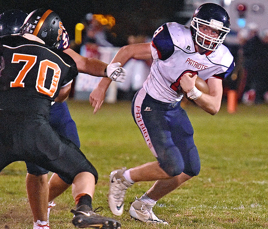 (Brad Davis/The Register-Herald) Independence quarterback Adam Daniels runs the ball against Summers County Friday night in Hinton.