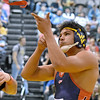(Brad Davis/The Register-Herald) Independence's Noah Adams celebrates by tossing his legband in the air and shooting it down after winning a state championship in the 220-pound weight class against Wirt's Mike Burns at the 70th Annual WVSSAC State Wrestling Tournament Saturday night at the Big Sandy Arena in Huntington.