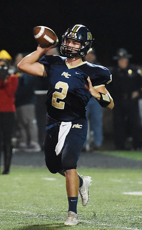 Nicholas County quarterback Jared Sagraves (2) attempts a pass during their high school football game against RIchwood Friday in Summersville. (Chris Jackson/The Register-Herald)