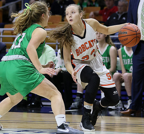 (Brad Davis/The Register-Herald) Summers County's Brittney Justice cuts back to let the offense set up as Charleston Catholic's Maddy Blaydes defends during the Lady Bobcats' opening round State Tournament win over the Irish Wednesday evening at the Charleston Civic Center.