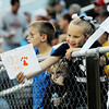 A young Meadow Bridge fan holds a sign towards a Meadow Bridge cheerleader as they talk prior to kickoff of their high school football game against Fayetteville in Meadow Bridge on Friday.  (Chris Jackson/The Register-Herald)