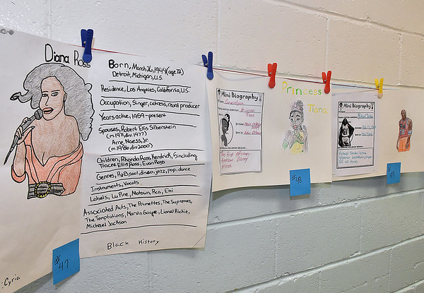 (Brad Davis/The Register-Herald) Students' Black History Month projects hang proudly on display in the cafeteria at Stratton Elementary School during a special Soul Food Luncheon Friday morning.