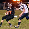 (Brad Davis/The Register-Herald) Summers County's Tucker Lilly rtries to dodge a tackle attempt from Greenbrier West's Chase Patterson tries to tackle him Friday night in Hinton.