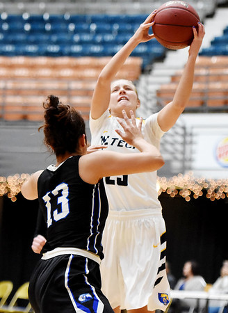 WVU Tech's Brittney Justice (23) attempts a shot over Ohio Christian's Shawntell Parsons (13) during the third quarter of their college basketball game Tuesday in Beckley. (Chris Jackson/The Register-Herald)
