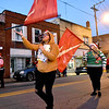 (Brad Davis/The Register-Herald) Holiday-themed flag corps members of the Oak Hill High School marching band wear Christmas lights and sweaters as they participate in the annual Oak Hill Christmas Parade Saturday evening.