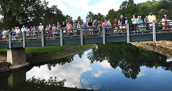 Spectators watching the final group approach the 18th green during the final round of The Greenbrier Classic.<br /> (Rick Barbero/The Register-Herald)