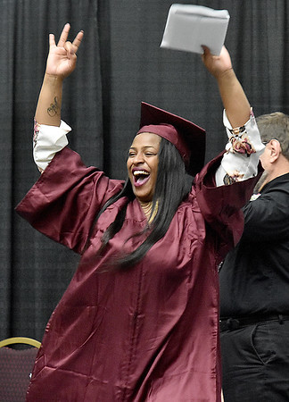 (Brad Davis/The Register-Herald) Woodrow Wilson senior Armani McDougald breaks into celebration as she collects her diploma during the school's 91st Commencement Saturday evening at the Beckley-Raleigh County Convention Center.