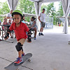 (Brad Davis/The Register-Herald) Skateboarding instructor Blair Burns, far right, can barely keep up as four-year-old Kolston Trim, seemingly a natural on a board, zips around the skateboarding demo area during a Veterans Appreciation Day event at the Boy Scouts Summit Bechtel Reserve Saturday afternoon. The B.S.A. teamed up with with the West Virginia National Guard to put on the 3rd annual festival-style event geared towards veterans and their immediate family members as well as the general public, with activities and live music going on throughout the day.