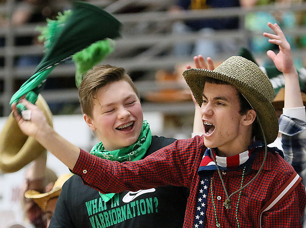 (Brad Davis/The Register-Herald) Wyoming East students react to events on the court as their Warrior classmates take down cross-county rival Westside for the Class AA Region 3, Section 1 championship Saturday night at the Beckley-Raleigh County Convention Center.