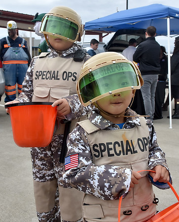 (Brad Davis/The Register-Herald) Elite soldier brothers Kaden (right), 3, and Jaden Nguyen, 8 are on a mission to collect as much candy as possible during Tailgate Halloween Saturday afternoon atop Beckley's Intermodal Gateway.