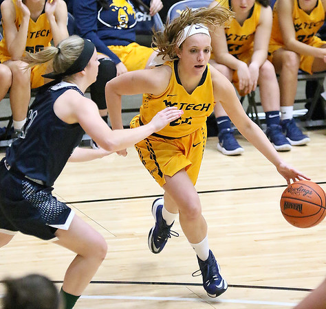 (Brad Davis/The Register-Herald) WVU Tech's Alexandra Combs finds an opening along the perimeter as Mount Vernon Nazarene's Sierra Basista defends Tuesday night at the Beckley-Raleigh County Convention Center.