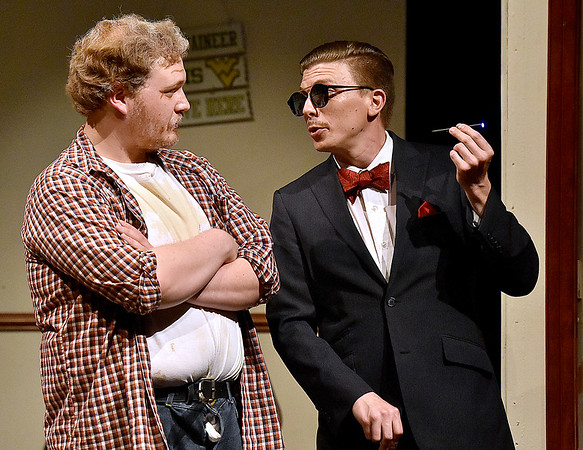 (Brad Davis/The Register-Herald) Jim is visited by sly businessman Falcone, played by Jamie Smith, during a scene from FRACK! Saturday night at The Raleigh.
