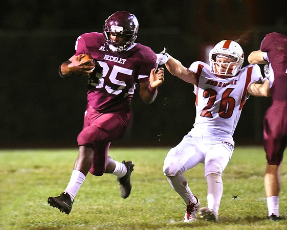 Tyree Swafford, of Woodrow Wilson, left, breaks away from Charles Womack, of Hurricane, and scored a touchdown in the first half Friday night at Van Meter Stadium in Beckley.<br /> (Rick Barbero/The Register-Herald)
