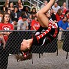 An Oak Hill Cheerleader goes head-over-heels before the big game. Chad Foreman for the Register-Herald.