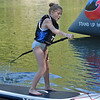 (Brad Davis/The Register-Herald) Young paddleboarder Emee Smith competes in the kids race Sunday afternoon on the New River near Fayette Station.