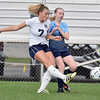 (Brad Davis/The Register-Herald) Shady Spring's Liz Adkins sends a ball downfield before Midland Trail's Caitlin Rider can stop her Thursday evening at the YMCA Paul Cline Memorial Soccer Complex.