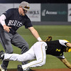 (Brad Davis/The Register-Herald) Miners baserunner Colby Johnson is barely tagged out by Butler 1st baseman Patrick Ferguson as he tries to dive into the unmanned base Wednesday night at Linda K. Epling Stadium.