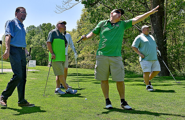 (Brad Davis/The Register-Herald) Football coach Doc Holliday (2nd from left) watches as Marshall University supporter and Summers County Assessor Greg Vandall (2nd from right) gestures for his ball to go anywhere except the direction he hit it in off the 14th tee during the 27th Annual Beckley Athletic Club of Marshall University (BAC-MU) Big Green Golf Outing Monday afternoon at Grandview. Group mates (from left) David Mann, Billy Rhodes (hidden behind Holliday) and Richard Crisp look on as they wait for their turns.