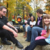 (Brad Davis/The Register-Herald) Five-year-old Brooklyn Brannen, far right, enjoys the fall scenery as she, dad Matt Brannen, far left, mom Rachel Walkep (second from right, head turned) and a handful of others roll through the woods on a hay ride during Burlington United Methodist Family Services' annual Pumpkin Festival Sunday afternoon near Prosperity.