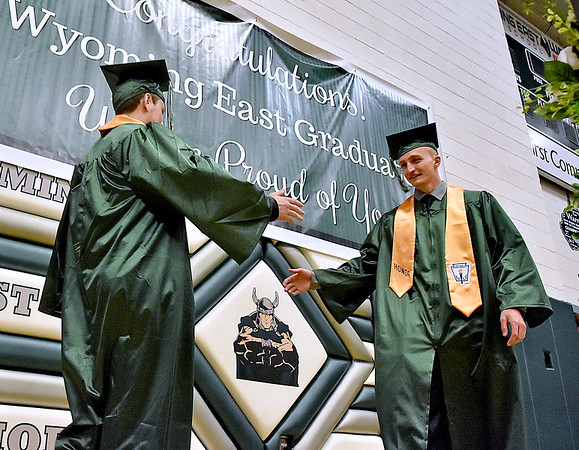 (Brad Davis/The Register-Herald) Graduating Wyoming East seniors make their entrance during the school's 2017 Commencement Ceremony Sunday afternoon in New Richmond.