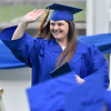 (Brad Davis/The Register-Herald) A Graduating Greenbrier West High School senior waves at family and friends up in the stands during the school's 2017 Commencement Ceremony Saturday evening at the State Fairgrounds in Fairlea.